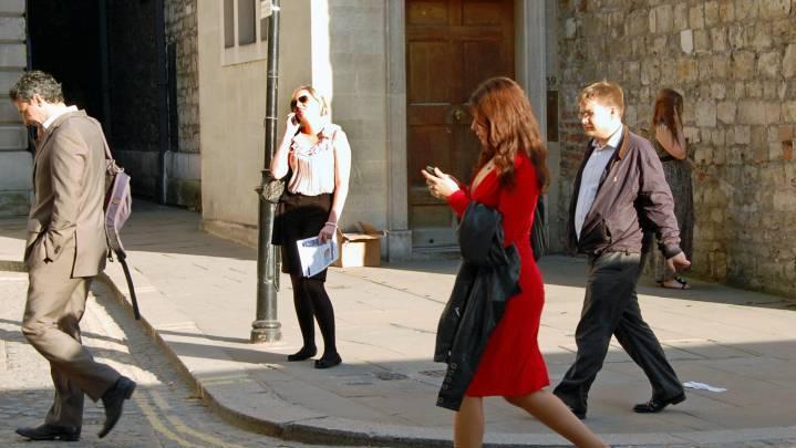 People walking on the street using their phones