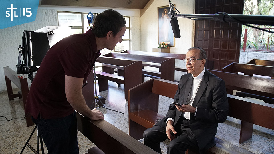 "Sebastian speaks with Cardinal Gregorio Rosa Chávez, the auxiliary bishop of San Salvador, in the chapel where soon-to-be-saint Oscar Romero was gunned down in 1980. The Cardinal's interview is part of S+L's upcoming documentary ""The Francis Impact,"" which Sebastian is currently producing and directing."