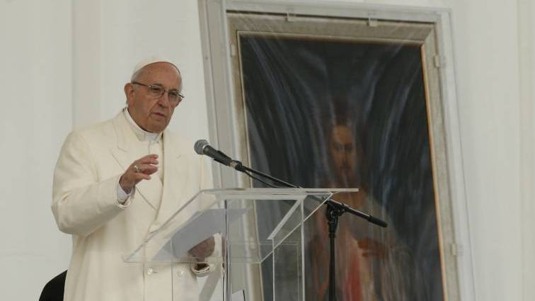 An image of Jesus of Divine Mercy is seen as Pope Francis speaks at a meeting with young people in the square adjacent to the cathedral in Vilnius, Lithuania