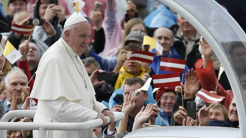 Pope Francis greets the crowd before celebrating Mass at the Shrine of the Mother of God in Aglona, Latvia.