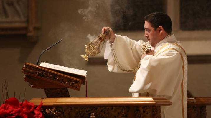 Deacon incenses the Book of the Gospels