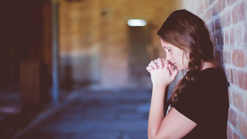 Girl praying alone