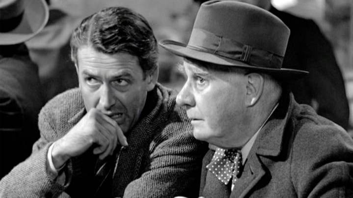 A scene featuring the characters George Bailey and Clarence Odbody in It's A Wonderful Life