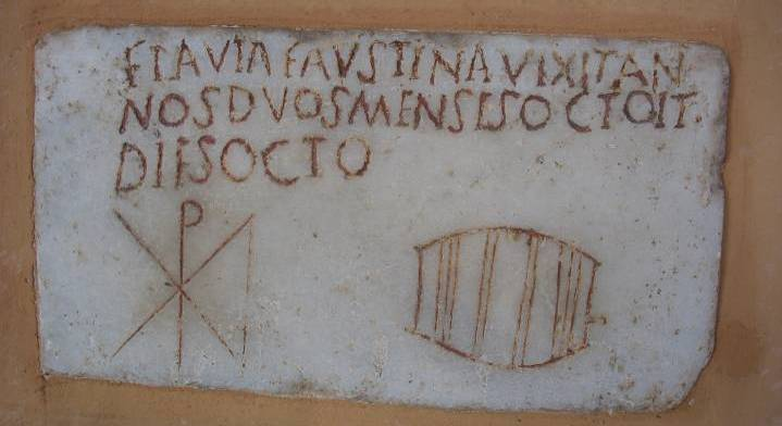4th-century funerary inscription with Chi-Rho Christogram for Flavia Faustina, who died at age 2 years, 8 months, and 8 days. This inscription can be seen by visitors to the Basilica of St. Paul Outside the Walls in Rome.
