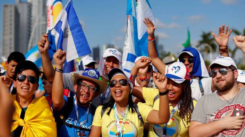 Pilgrims cheer before the World Youth Day opening Mass in Panama City Jan. 22, 2019. (CNS photo/Carlos Jasso, Reuters)