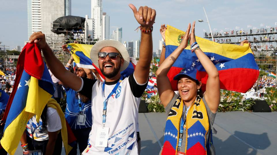 World Youth Day pilgrims cheer as they wait for Pope Francis' arrival for the welcoming ceremony and gathering with young people at Santa Maria la Antigua Field in Panama City on Jan. 24, 2019. (CNS photo/Paul Haring)