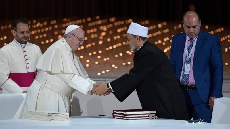 Pope Francis and Sheikh Ahmed el-Tayeb shake hands during a document signing at a meeting at The Founder's Memorial in Abu Dhabi. (Vatican Media)