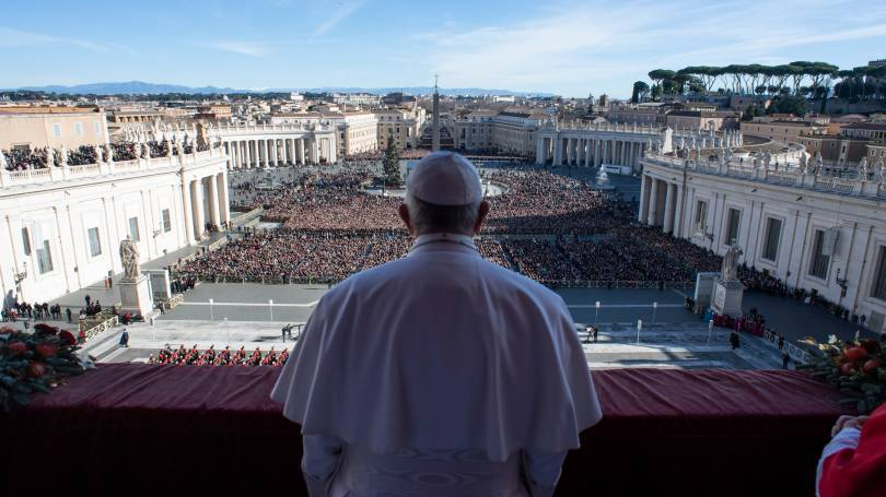 "Pope Francis leads his Christmas message and blessing ""urbi et orbi"" (to the city and the world) delivered from the central balcony of St. Peter's Basilica at the Vatican on Dec. 25, 2018. (CNS photo/Vatican Media)"