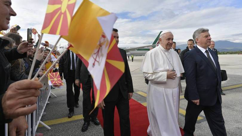 Pope Francis walks with Prime Minister Zoran Zaev and President Gjorge Ivanov of North Macedonia as he arrives at the international airport in Skopje, North Macedonia, May 7, 2019. (CNS photo/Vatican Media)
