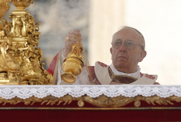 Pope Francis uses incense as he begins Palm Sunday Mass at Vatican