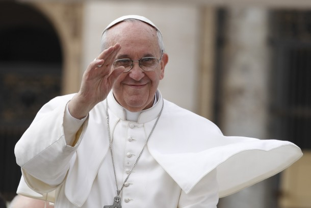 Pope Francis greets crowd as he leaves general audience in St. Peter's Square at Vatican