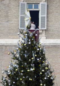 Pope waves as he arrives to lead Angelus at Vatican