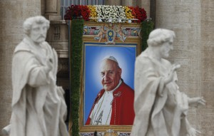 Banner depicting St. John XXIII hangs at Vatican