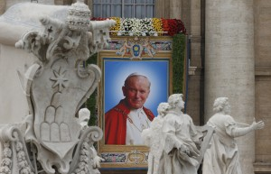 Banner depicting St. John Paul II hangs at Vatican