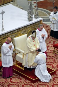 Pope Francis lays his hands on newly ordained priest during Mass in St. Peter's Basilica at Vatican