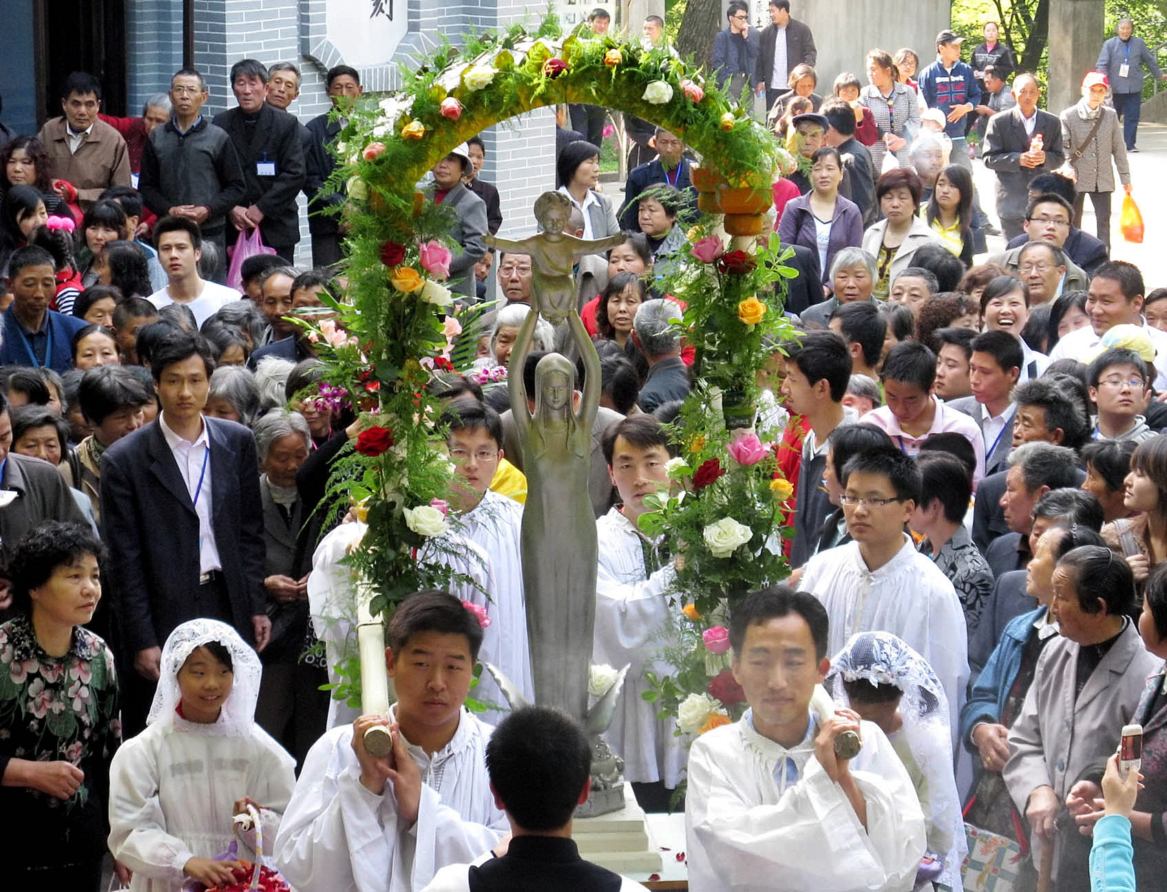 CATHOLICS CARRY STATUE OF MARY AS THEY PROCESS TO SHESHAN MARIAN SHRINE IN CHINA