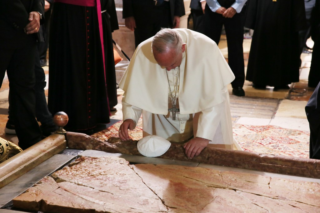 Pope kneels before Stone of Unction in Jerusalem's Church of the Holy Sepulcher