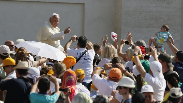 Pope Francis greets crowd as he arrives in St. Peter's Square at Vatican