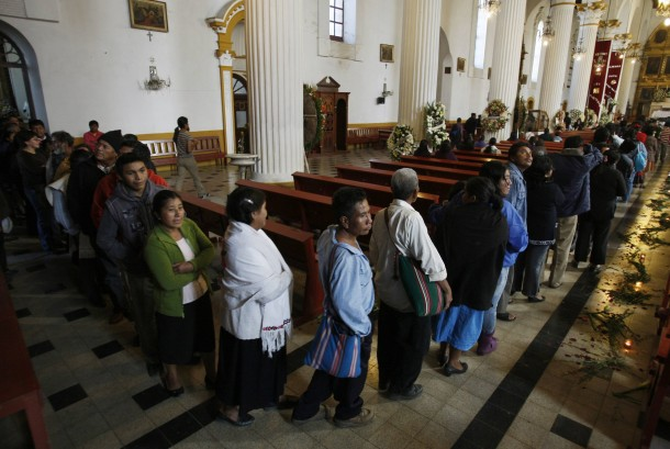 PEOPLE ARRIVE FOR VIEWING OF BISHOP AT MEXICAN CATHEDRAL