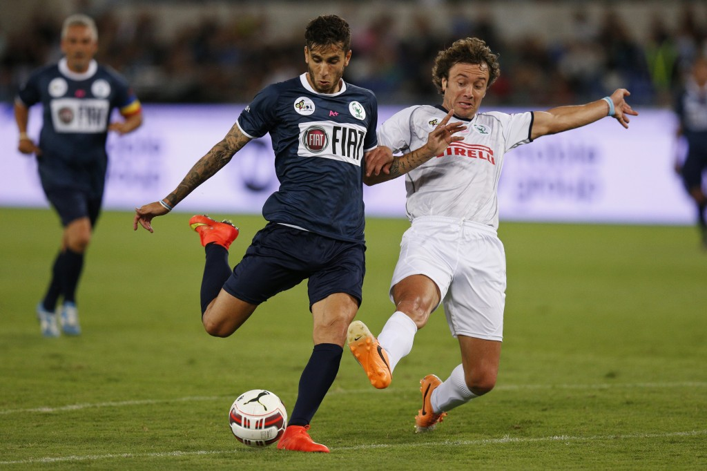 Argentine soccer player Ricky Alvarez competes against Uruguayan Diego Lugano during 'Interreligious Match for Peace'