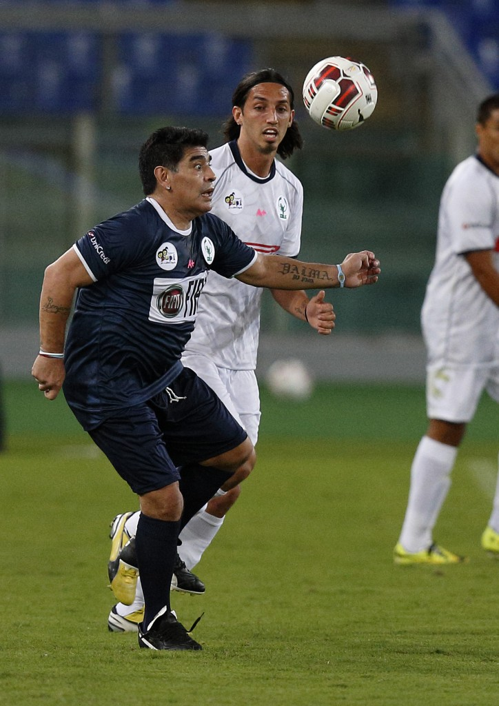 Former Argentine soccer star Diego Maradona competes in 'Interreligious Match for Peace'
