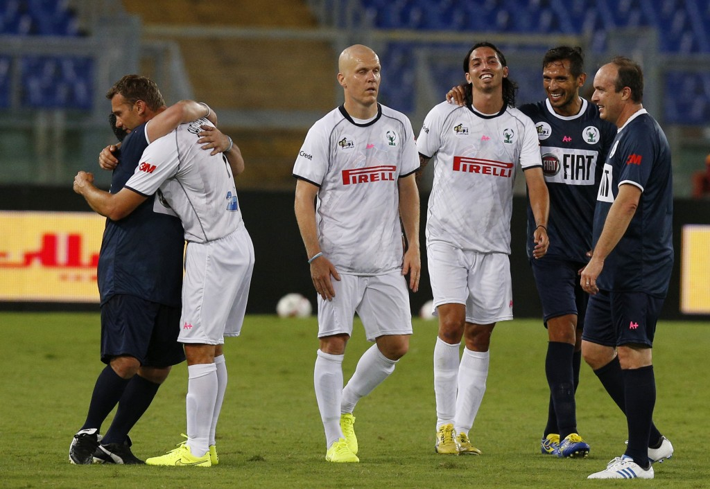 Player embrace at conclusion of  'Interreligious Match for Peace' in Rome