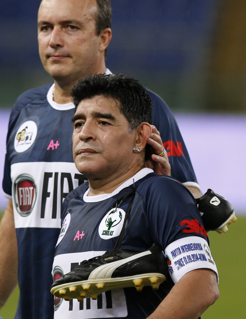 Former Argentine soccer star Diego Maradona walks off field after playing in 'Interreligious Match for Peace'