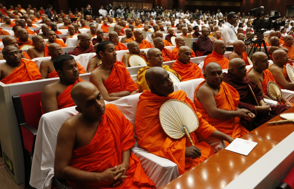 Buddhist monks attend Pope Francis' meeting with religious leaders in Colombo, Sri Lanka