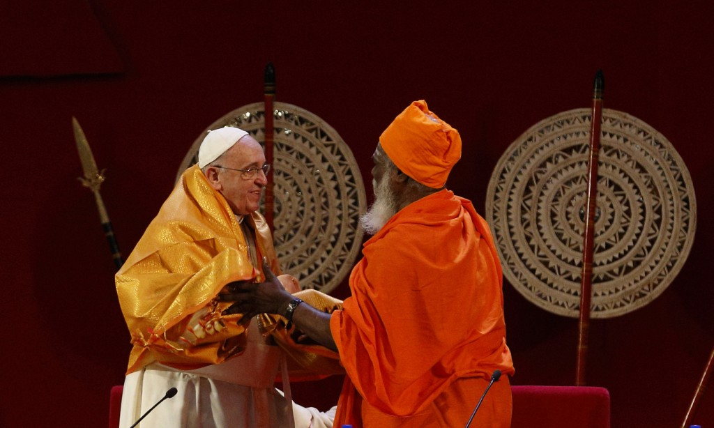 Pope Francis receives robe during meeting with religious leaders in Colombo, Sri Lanka