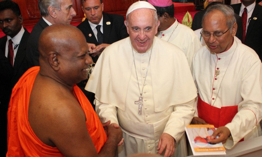 Pope Francis is greeted by a senior monk  during a meeting with religious leaders in Sri Lanka