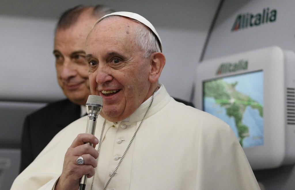 Pope Francis greets media aboard flight to Colombo, Sri Lanka
