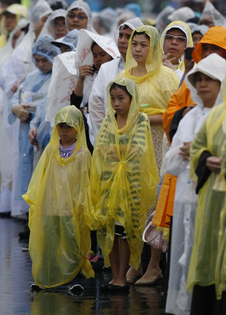People attend Pope Francis' celebration of Mass at Rizal Park in Manila, Philippines