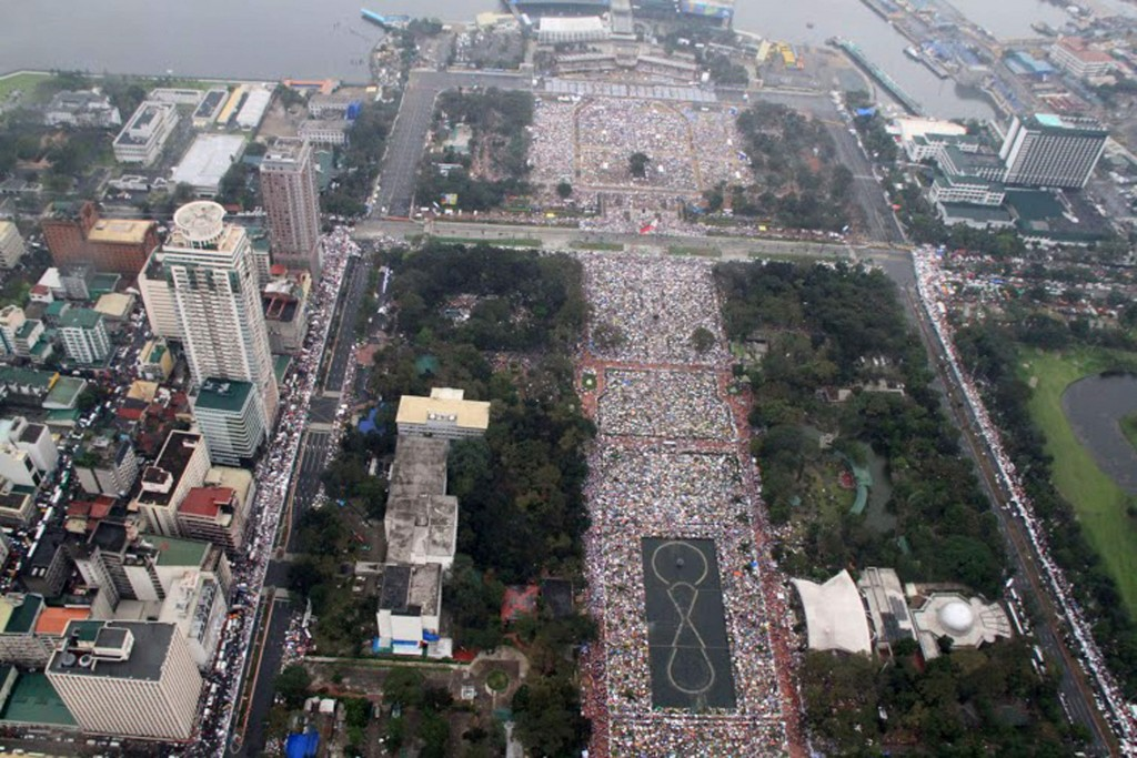 Handout photo shows aerial view of pilgrims gathering to hear Mass celebtated by Pope Francis at Rizal Park in Manila, Philippines