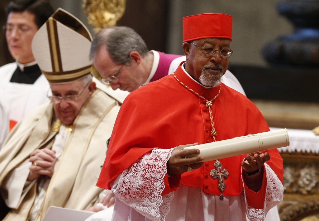 New Cardinal Souraphiel carries scroll during consistory in St. Peter's Basilica at Vatican