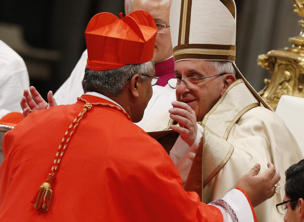 Pope Francis greets new Cardinal Mafi during consistory at which pope created 20 new cardinals in St. Peter's Basilica at Vatican